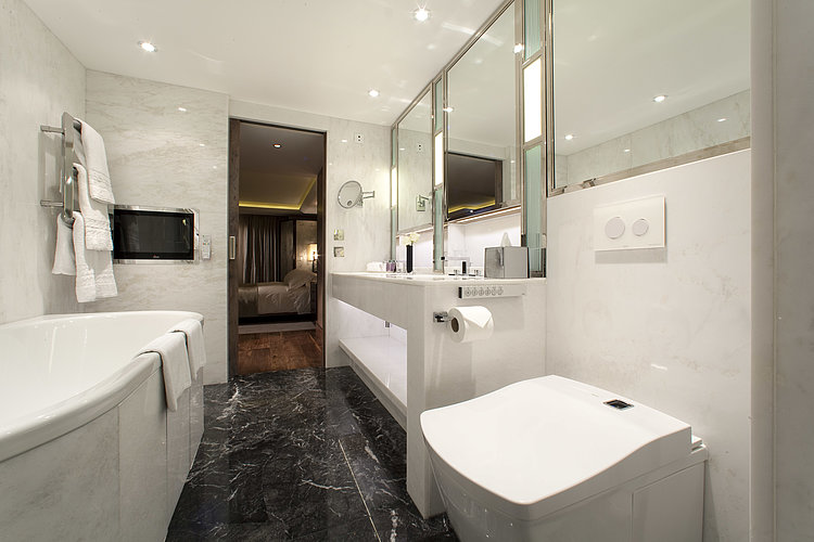 WASHLET™ in a bathroom with lots of marble