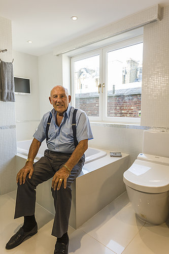 Sir Stirling Moss in his bathroom, with a WASHLET™