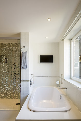 Bathroom with bathtub in Sir Stirling Moss's private residence in London