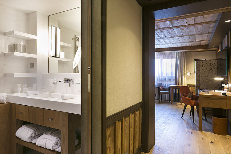 Suite with bathing and living areas at  Hotel Les Neiges in Courchevel
